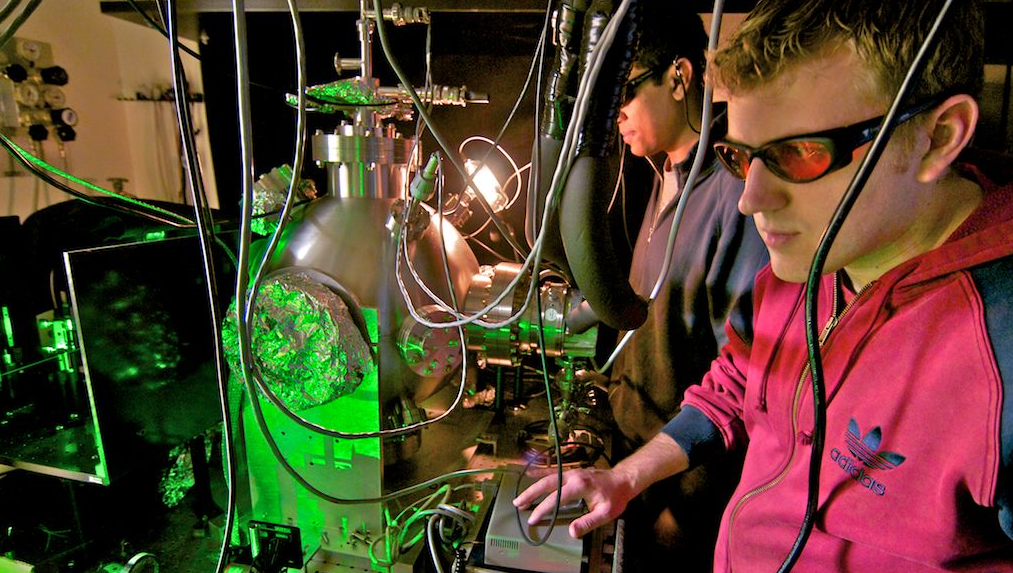 Graduate students using lasers