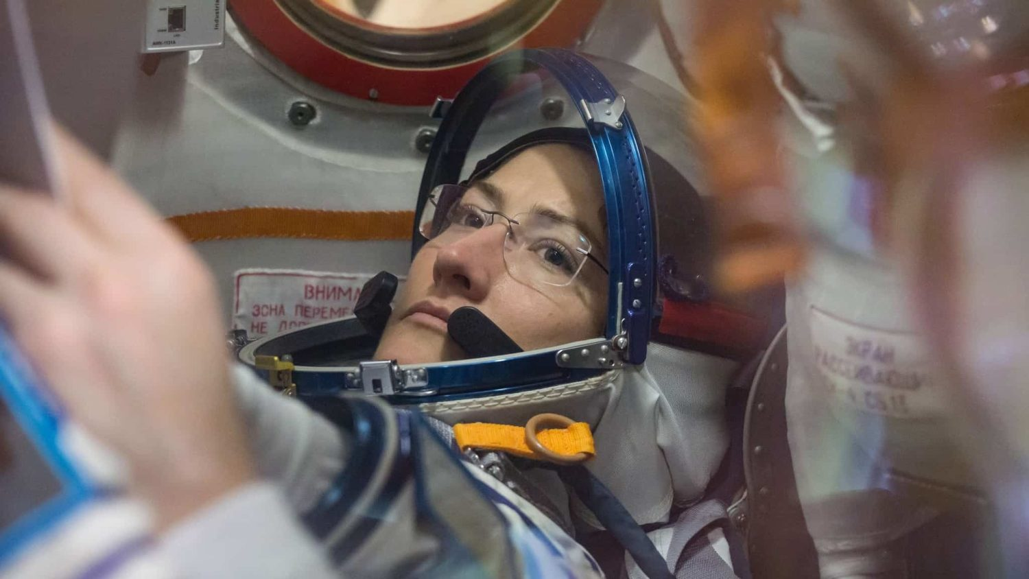Christina Koch in astronaut gear during training for her space launch